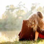Two teens outside hugging