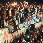 Angry protestors; crowds cheering as the Berlin Wall falls –  the role emotions play in protests