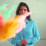 Teacher at board with paint explosion
