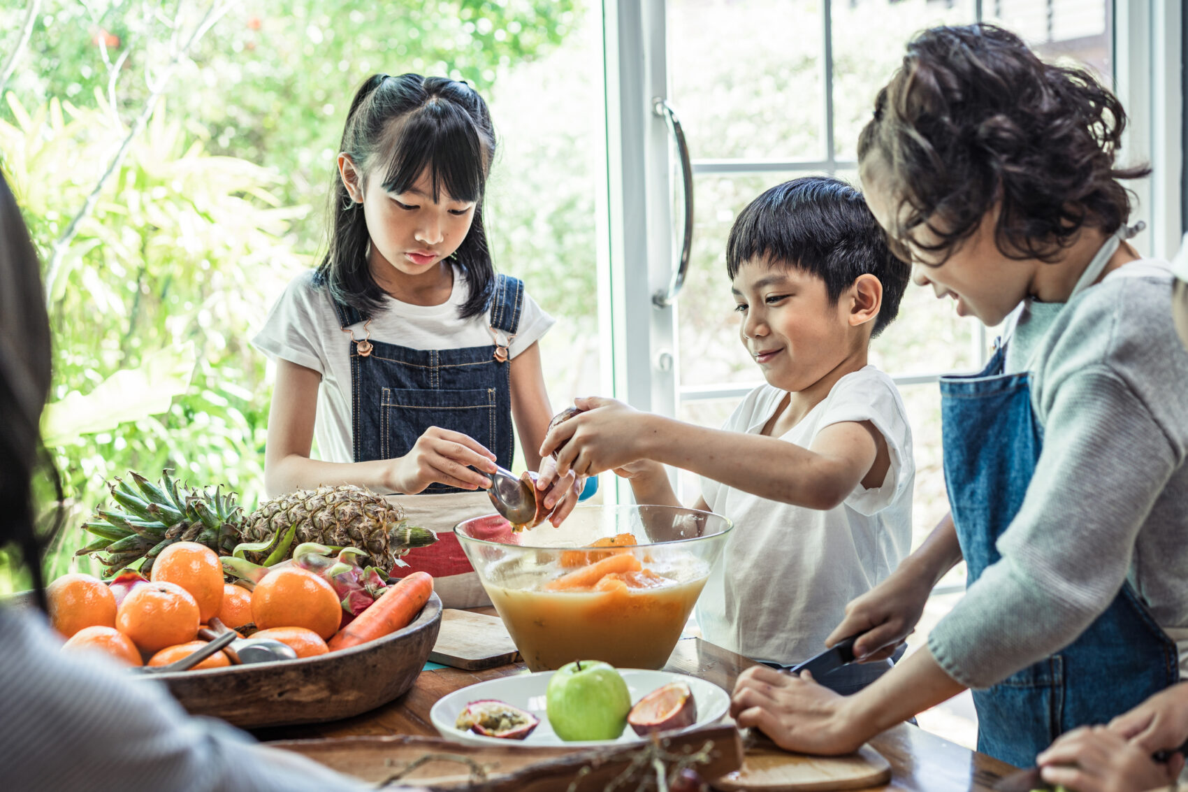 Asian students and friends learning cooking in the kitchen