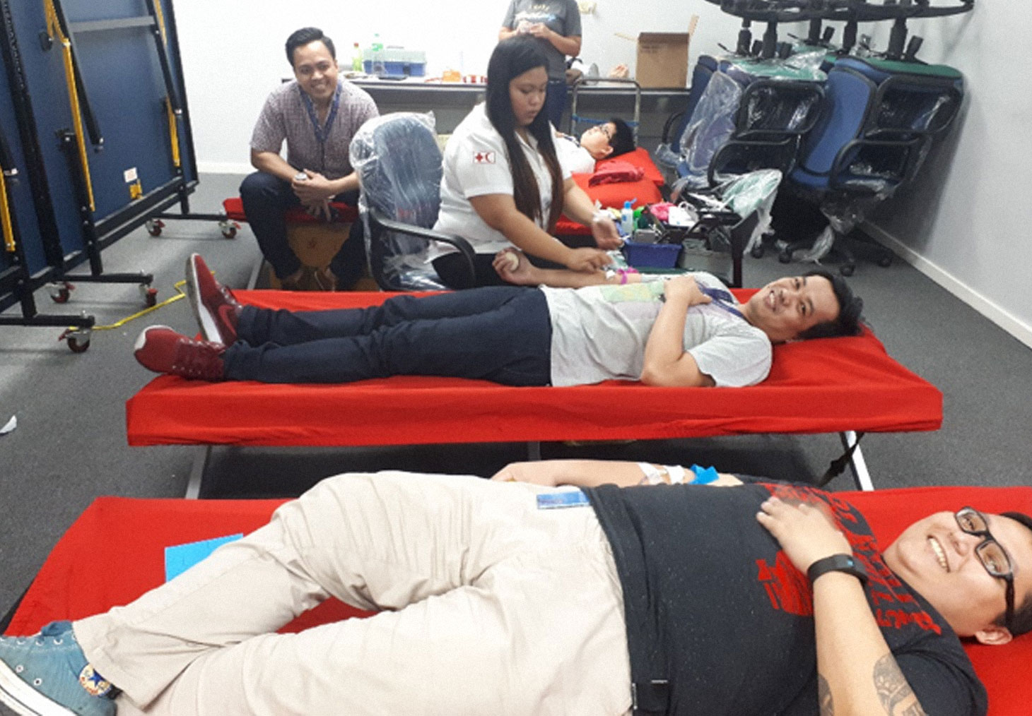 Cambridge University Press and Cambridge Assessment colleagues in the Manila office donate blood.