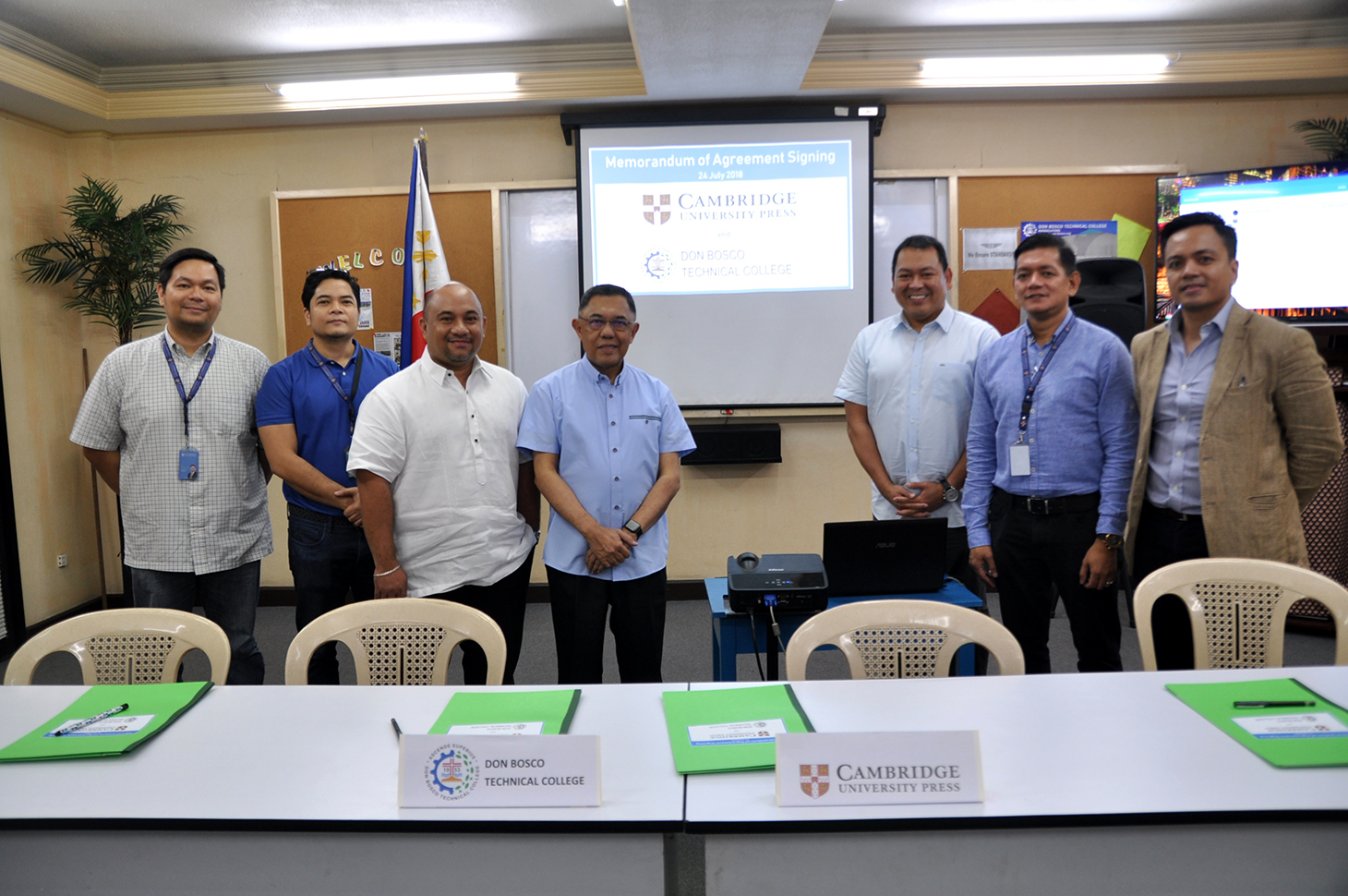 Colleagues sign the agreement at Don Bosco, Manila