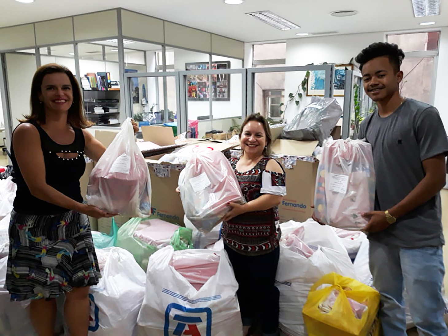 Colleagues in Brazil with Christmas bags for Grupo Amar