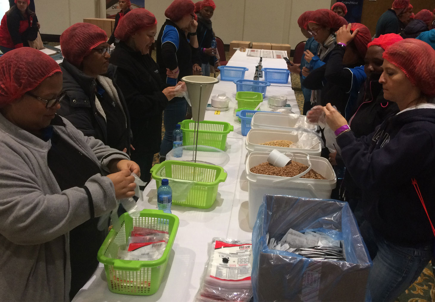 Colleagues packing meals for pre-school children for Rise against Hunger, on Mandela Day.