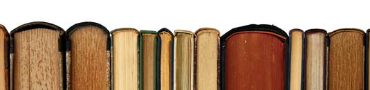 An image showing some antique books in a line