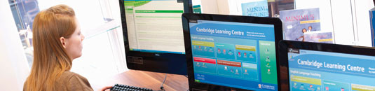 An image showing a young woman at a computer screen at the Cambridge University Press Learning Centre in Cambridge